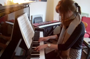 Becky during her piano lesson