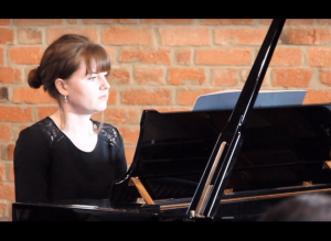 Becky performing on piano