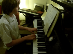 Ben playing during a lesson